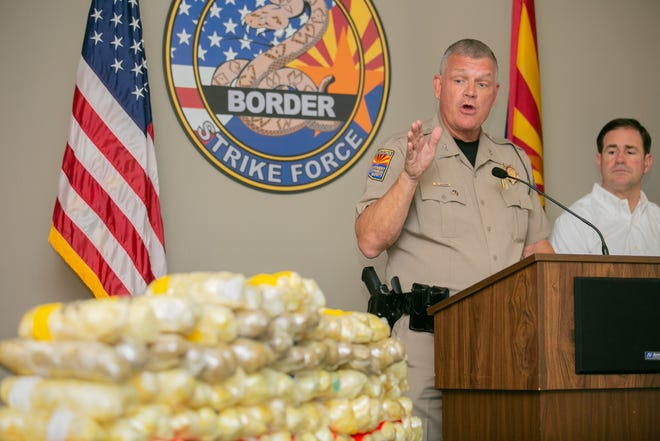 Frank Milstead, director of the Arizona Department of Public Safety, talks on Sept. 17, 2018, in Tucson about the 225 pounds of methamphetamine recently seized on southern Arizona freeways. Arizona Gov. Doug Ducey looks on.