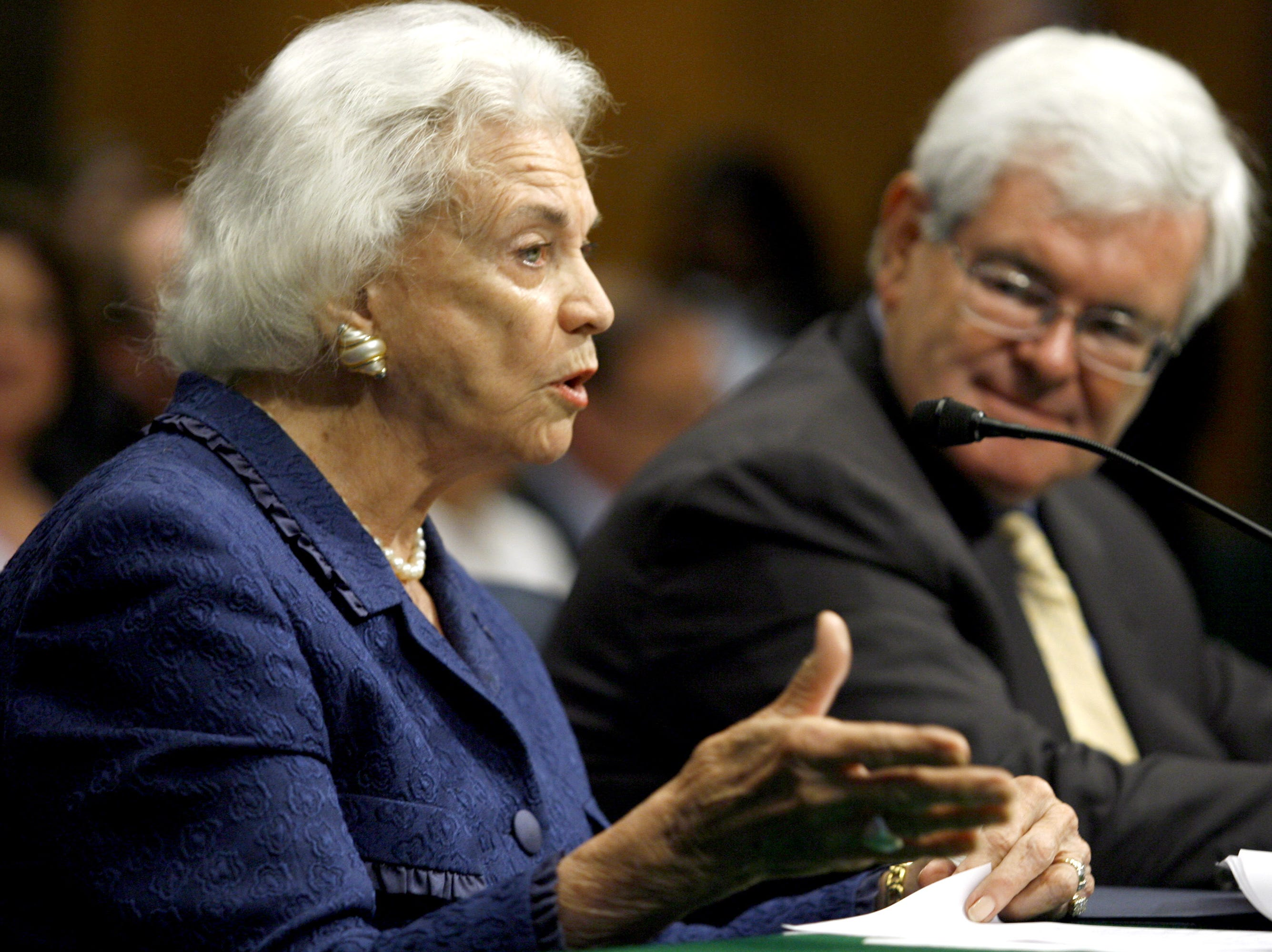 Former House Speaker Newt Gingrich, right, looks on as former Supreme Court Justice Sandra Day O'Connor testifies on Capitol Hill in Washington, Wednesday, May 14, 2008, before the Senate Special Committee on Aging hearing on Alzheimer's disease.