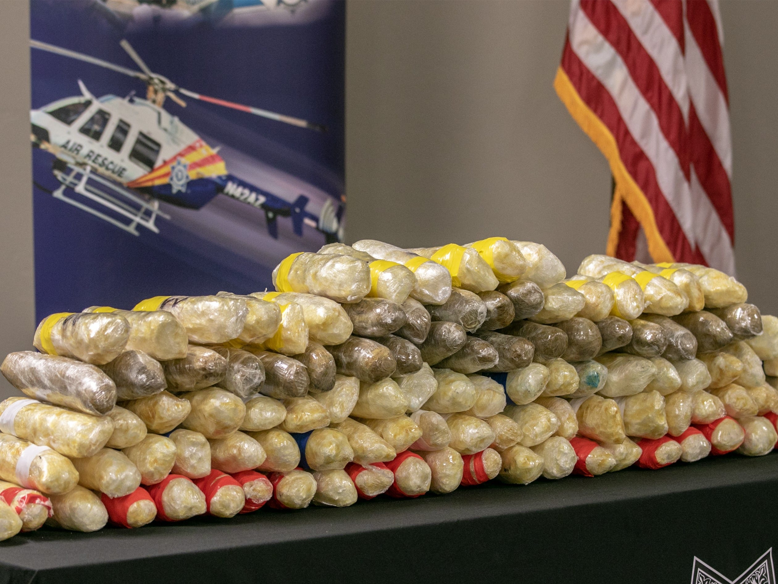 Some 225 pounds of methamphetamine seized during three traffic stops by troopers on southern Arizona freeways are displayed during a press conference on Sept. 17, 2018, in Tucson.