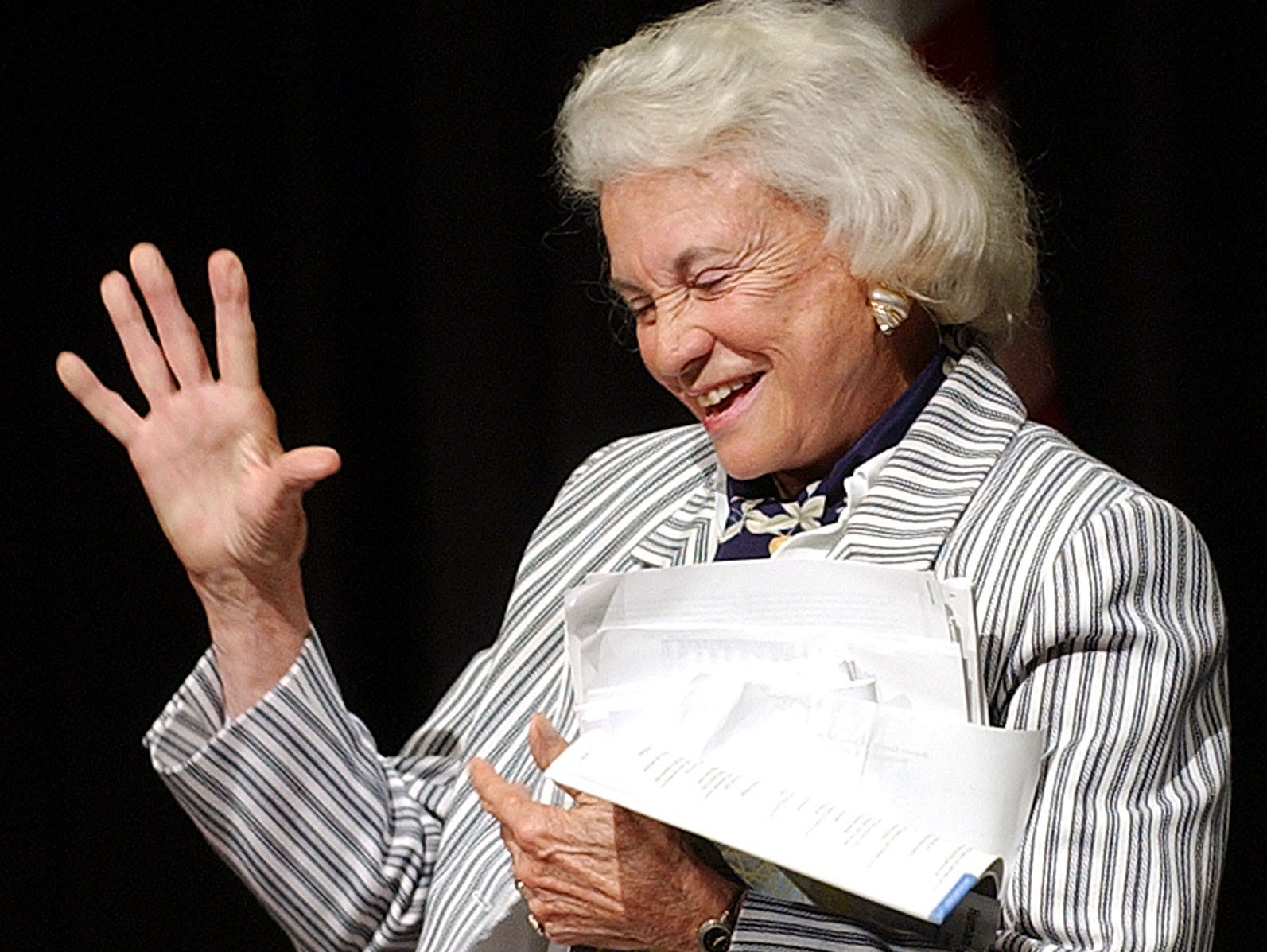 Associate Justice of the U.S. Supreme Court Sandra Day O'Connor waves as she departs the 2004 9th Circuit Judicial Conference Thursday, July 22, 2004, in Monterey, Calif.