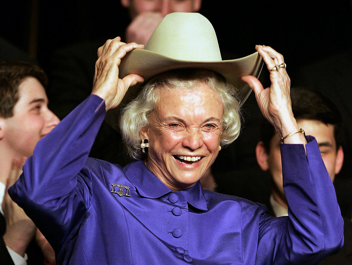 Supreme Court Justice Sandra Day O'Connor, an El Paso native, dons a cowboy hat, given to her during an event at the University of Houston Law Center, Thursday, March 10, 2005, in Houston.