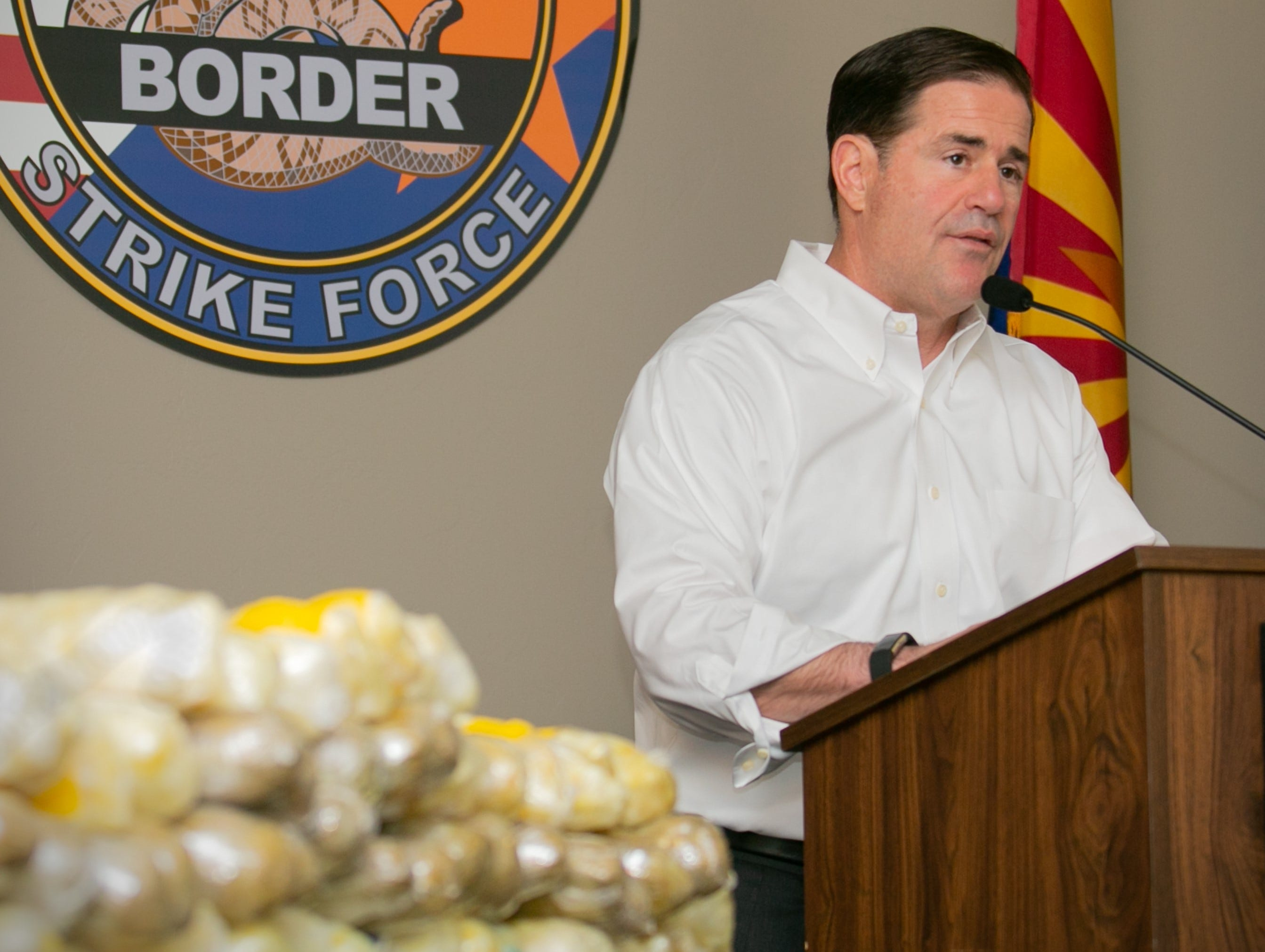 Arizona Gov. Doug Ducey speaks on Sept. 17, 2018, in Tucson about about the Border Strike Force's seizure of 225 pounds of methamphetamine by troopers during three traffic stops on southern Arizona freeways.