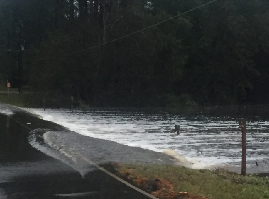 Flooding caused from Hurricane Florence washing up on to a road in North Carolina, Sept. 16, 2018.