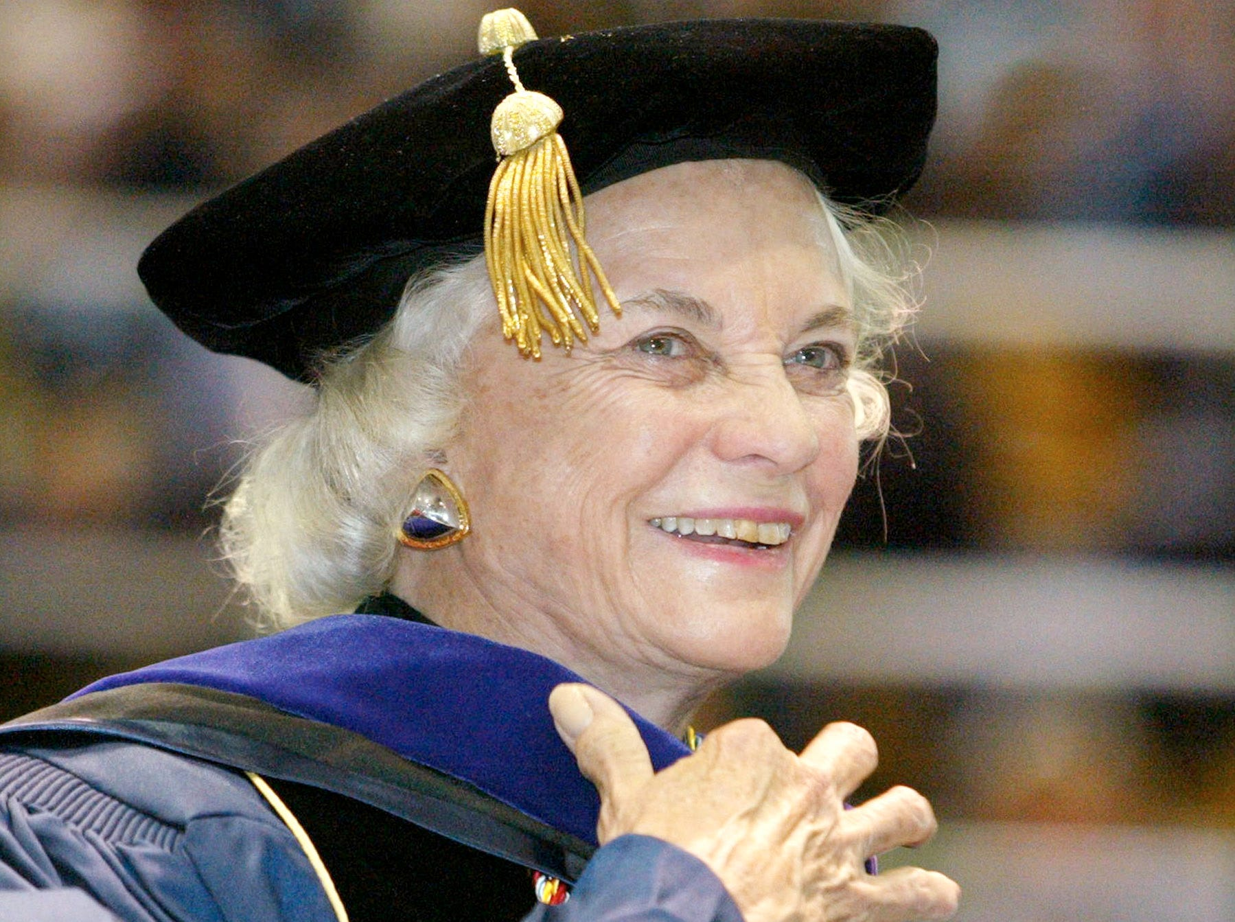 Supreme Court Justice Sandra Day O'Connor smiles during commencement ceremonies  at the George Washington University Law School, May 25, 2003, in Washington.