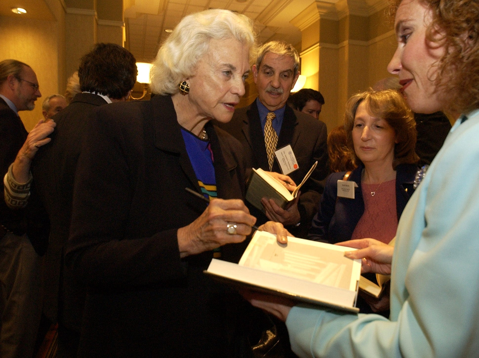 United States Supreme Court Justice Sandra Day O'Connor, left, signs her book for attorney Carolyn Mirabile, right, of Norristown, Pa., at the American Inns of Courts banquet in Philadelphia, Friday, May 16, 2003.