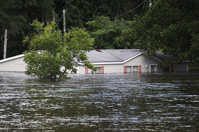 Floods caused by Hurricane Florence overwhelm a home in the Carolinas.