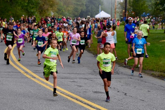 Kids mile runners take part in the 40th Dutchess County Classic in September in LaGrangeville.