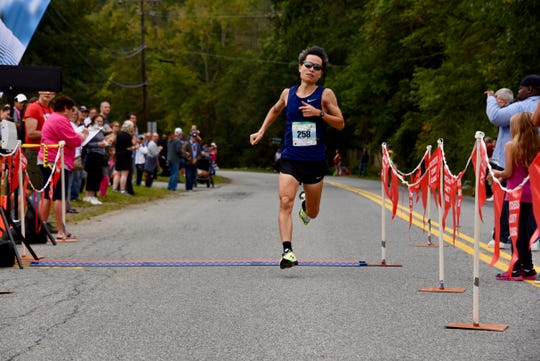 Mike Chow wins the 40th Dutchess County Classic five-kilometer race on Sunday in LaGrangeville.