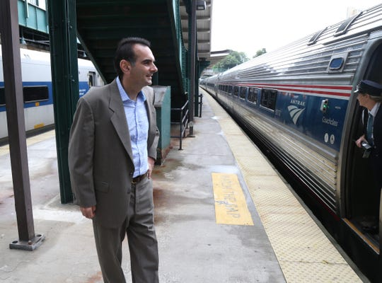 A rail travel enthusiast, Tom Martinelli admires an AMTRAK train as it pulls into the Poughkeepsie train station on September 13, 2018. Martinelli is the publisher of New York By Rail magazine.