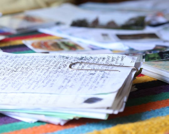 A large paper clip holds together a stack of letters Gloria Ghedini has received from pen pals over the years at her home in Pleasant Valley on September 13, 2018.