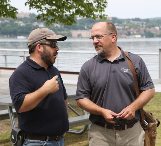 From left, Joe Kiernan, Scenic Hudson's Senior Parks Project Manager, and Andrew Peck, the Nature Conservancy's freshwater project manager for New York discuss the Hudson River restoration plan at Long Dock Park in Beacon on July 30, 2018.