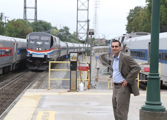 Tom Martinelli on the platform at the Poughkeepsie train station as an AMTRAK train pulls in on September 13, 2018. Martinelli is the publisher of New York by Rail magazine which explores rail travel throughout New York, Vermont and Canada.