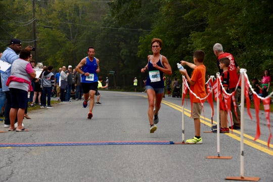 Marisa Sutera-Strange wins the women's five-kilometer title for the 19th consecutive time at the 40th Dutchess County Classic on Sunday in LaGrangeville.
