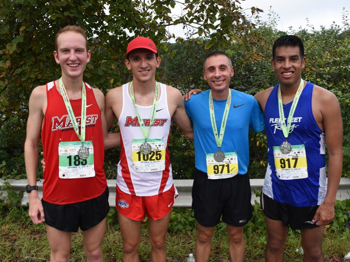 Four of the top five half-marathon finishers pose together at the 40th Dutchess County Classic on Sunday in LaGrangeville. From left, Dietrich Mosel (second), Nick Cruz (first), Jamie Stroffolino (third) and Omar Perez (fourth.