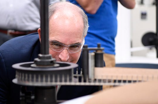 Senator Bob Casey (D-PA) takes a close look at a machine while touring Tooling Dynamics on Volgelsong Road to celebrate his bipartisan legislation being signed into law by President Trump, Monday, Sept. 17, 2018.  John A. Pavoncello photo