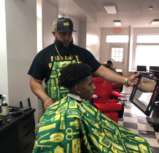 "Isaac ""Jerz"" Mantilla, Sr. owns Fade Away Barbershop."