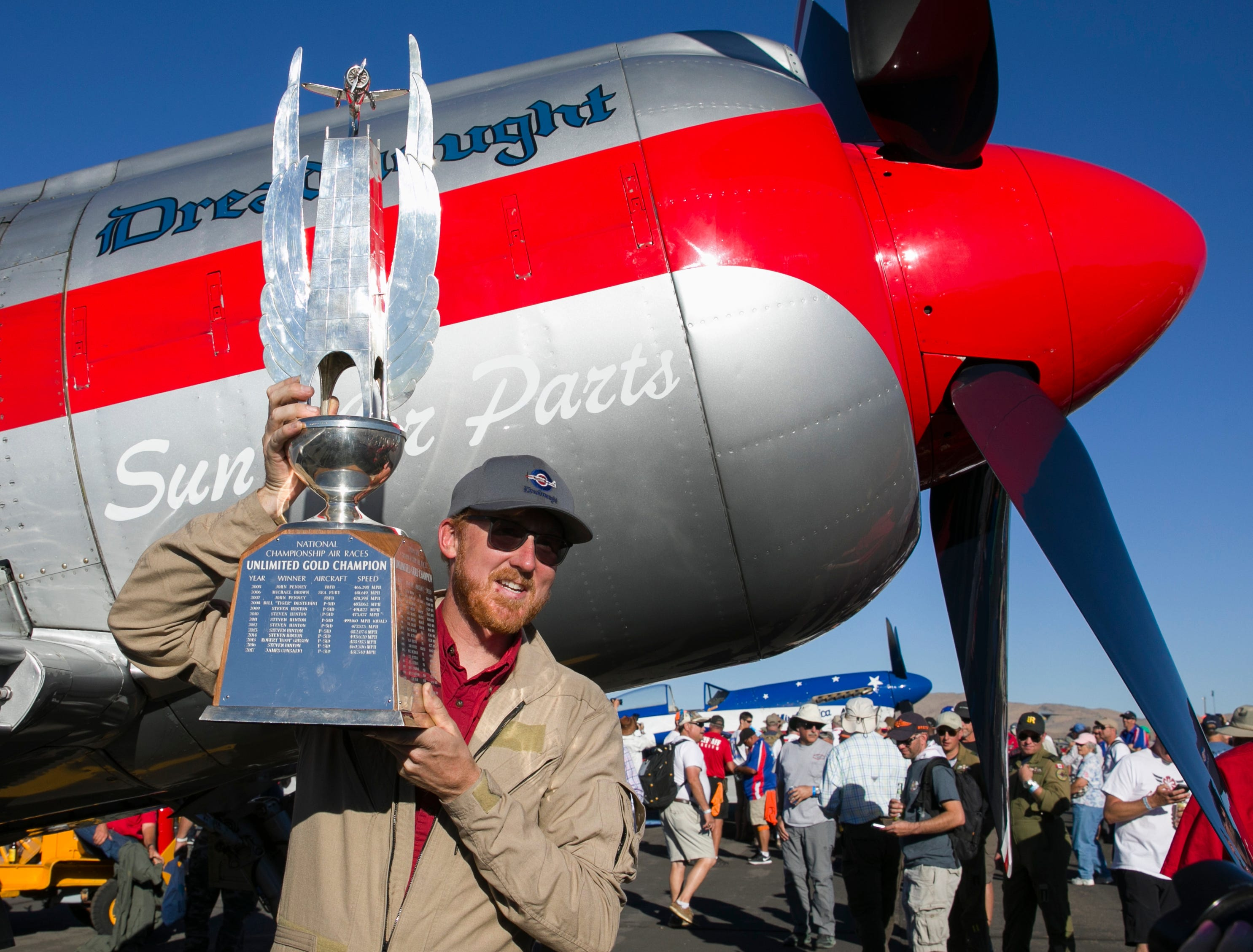 Joel Swager, Unlimited Gold Champion, holds up the trophy during the Reno National Championship Air Races on Sunday, Sept. 16, 2018.