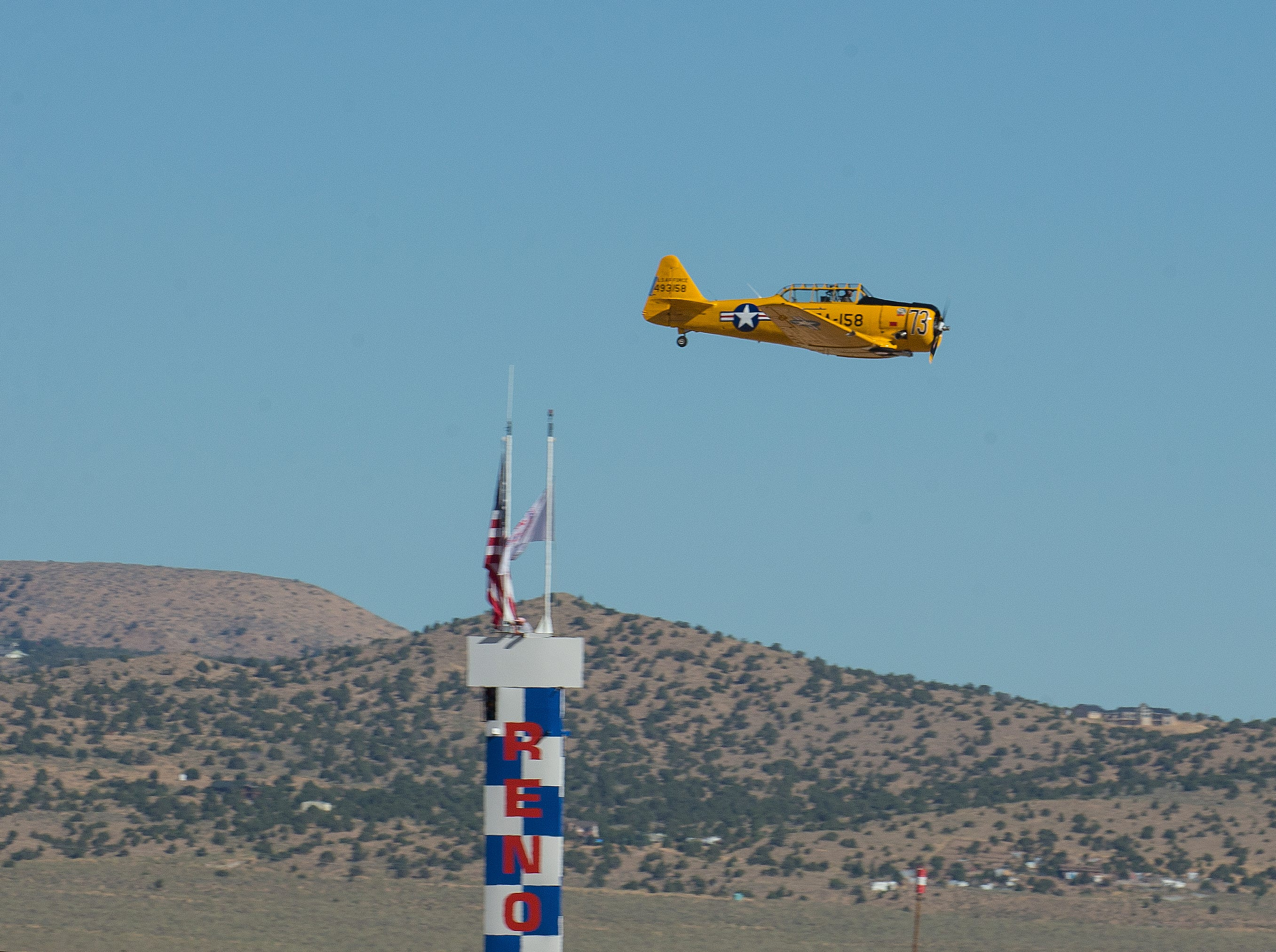 "Ralph Rina from Mesa, AZ flying ""Miss Humboldt Hunny"" won his T6 heat race during the Reno National Championship Air Races on Sunday, Sept. 16, 2018."