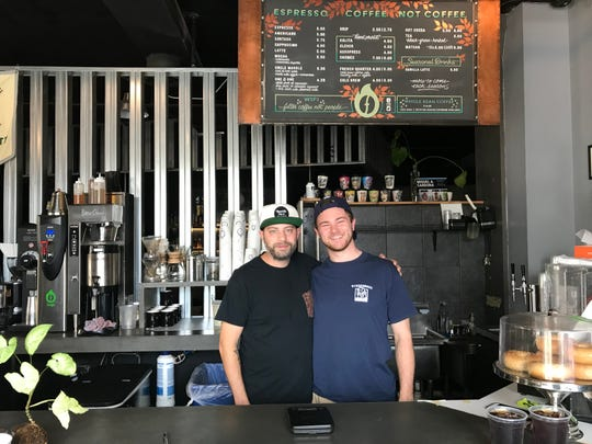 Tony Colon, owner, and Joe Reed, general manager, pause between customers at Fuego Coffee Roasters.