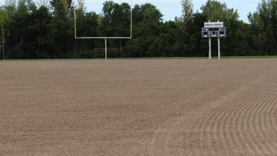Six inches of clean soil were added to the field