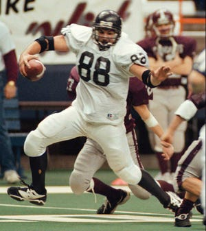 LeRoy's Brandon Shaughnessy runs for a big gain after making a key reception during the first quarter on the 1996 state championship game against Watervliet at the Carrier Dome. Watervliet won 20-19.