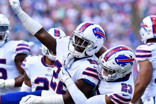 Vontae Davis, center, celebrates making a third-down stop in the first quarter of Sunday's game against the Chargers.