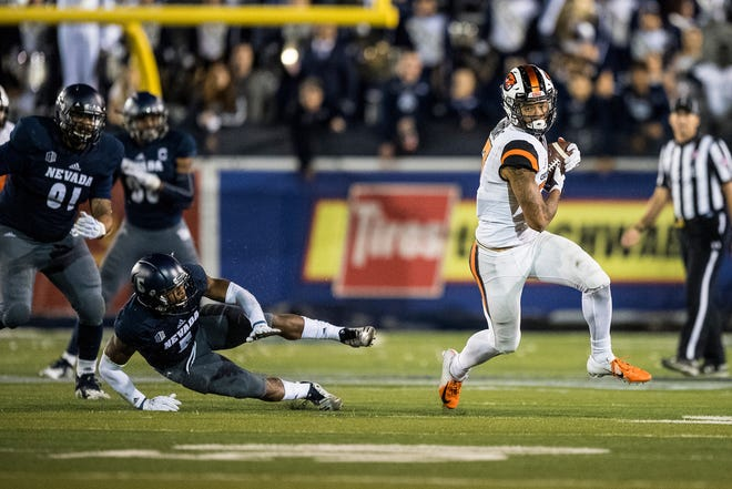 Oregon State Isaiah Hodgins had 14 receptions for 200 yards and two touchdowns in Saturday's 37-35 loss at Nevada.