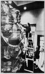 Sculptor Ken Hunt puts the finishing touches on the happy Buddha in the lobby of Kwan's Original Cuisine in a photo published Dec. 3, 1990 in the Statesman Journal.