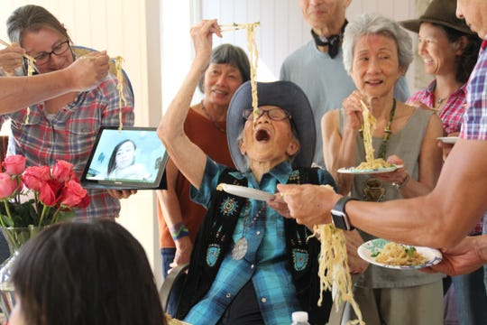 Dr. Marian Lowe eats longevity noodles with family at her birthday party Saturday, Sept. 15, 2018. Lowe is 100 years old, and the long noodles represent long life in Chinese culture.