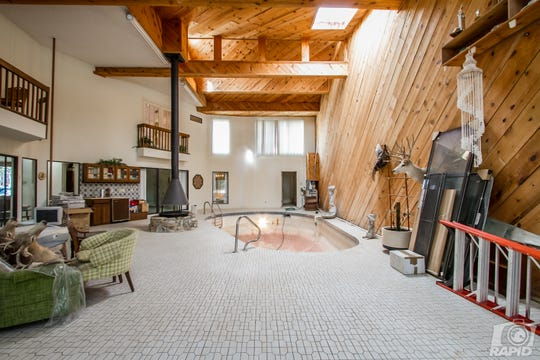 This indoor pool room at 2568 Lindenwood Dr. is 1,200 square feet total. The pool, at its deepest, is six feet.