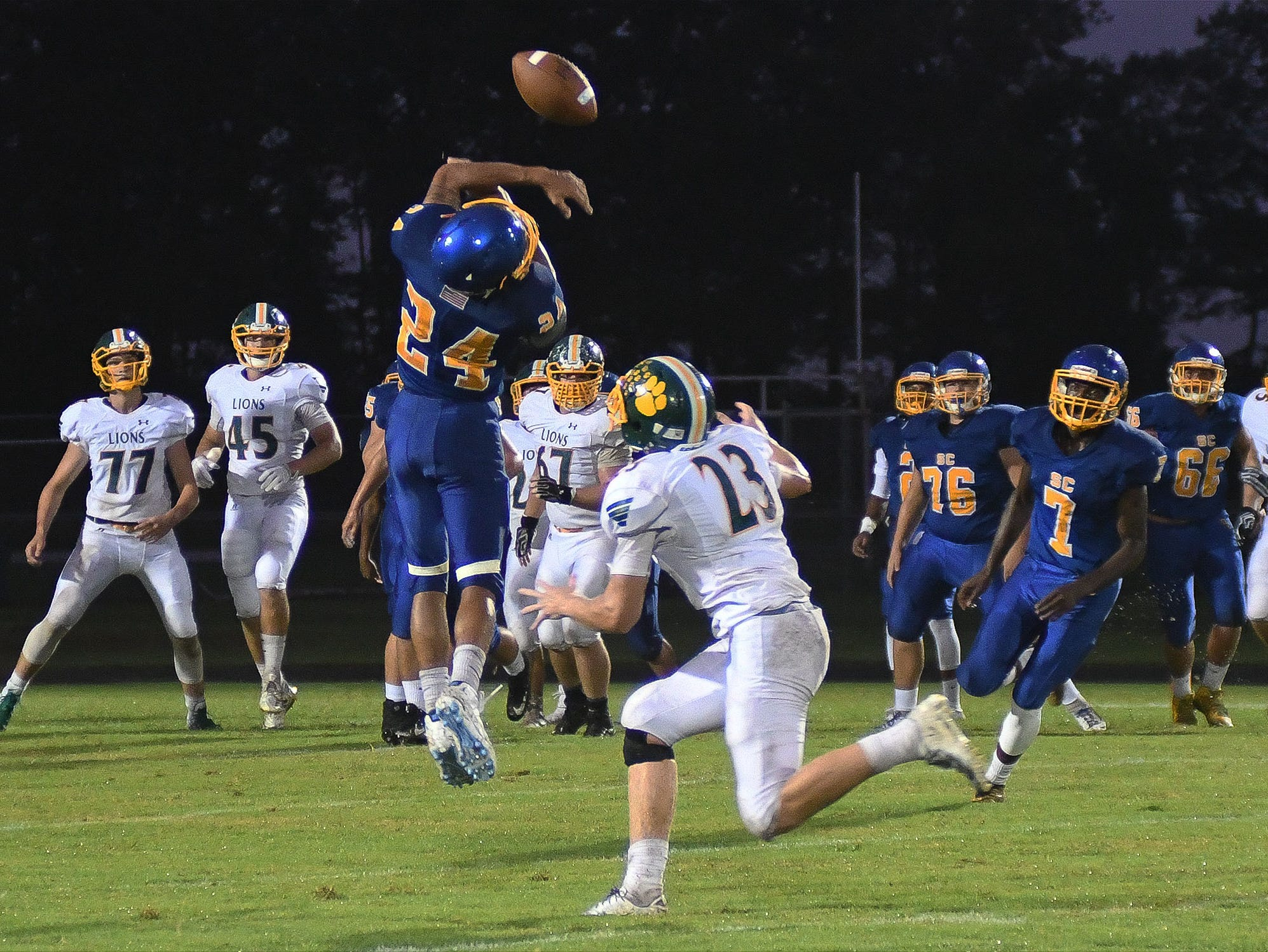 Sussex Central's Isaiah Barnes (24) breaks up a pass during the game against Queen Anne on Friday, Sept. 14, 2018.