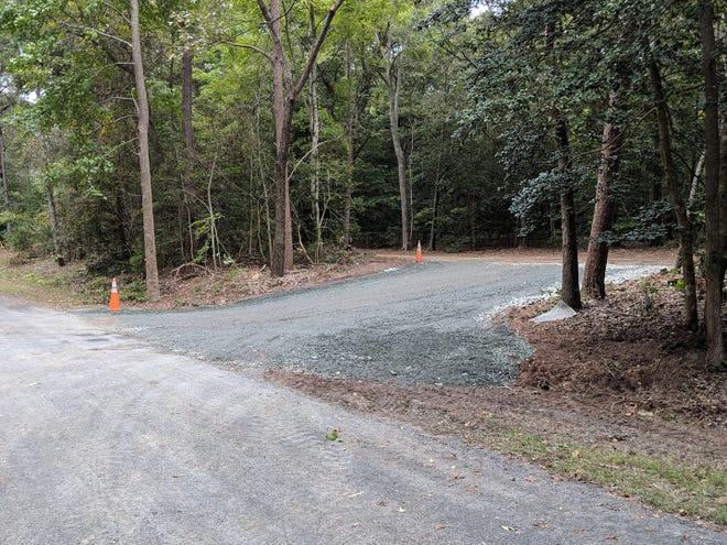This emergency access road into the Hillsborough community near Belle Haven, Virginia was completed after a deluge earlier in September washed out the only road into the subdivision.