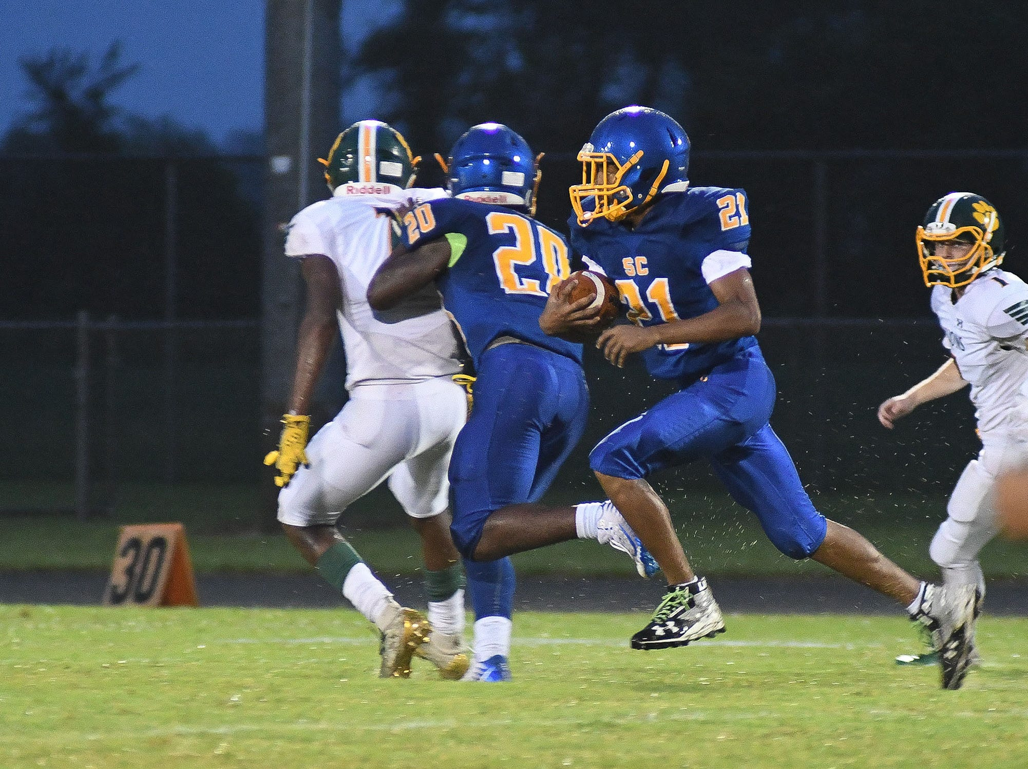 Sussex Central's TyJhir Sheppard-Parker (21) with the carry against Queen Anne on Friday, Sept. 14, 2018.