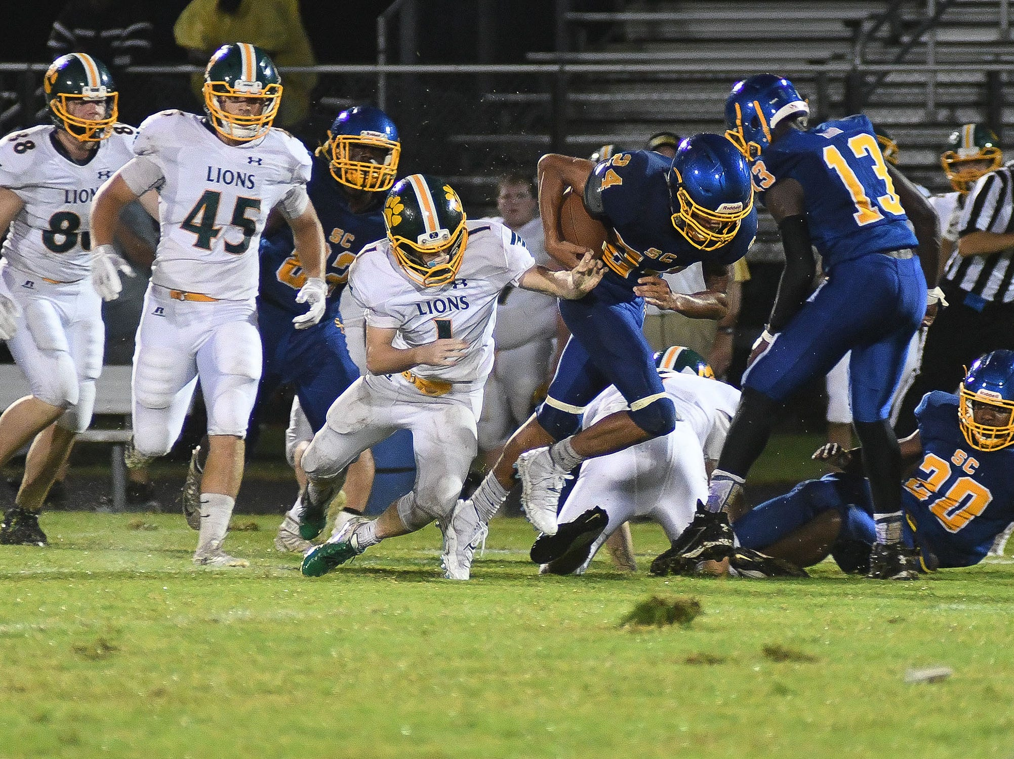 Sussex Central's Isaiah Barnes (24) runs the ball against Queen Anne on Friday, Sept. 14, 2018.