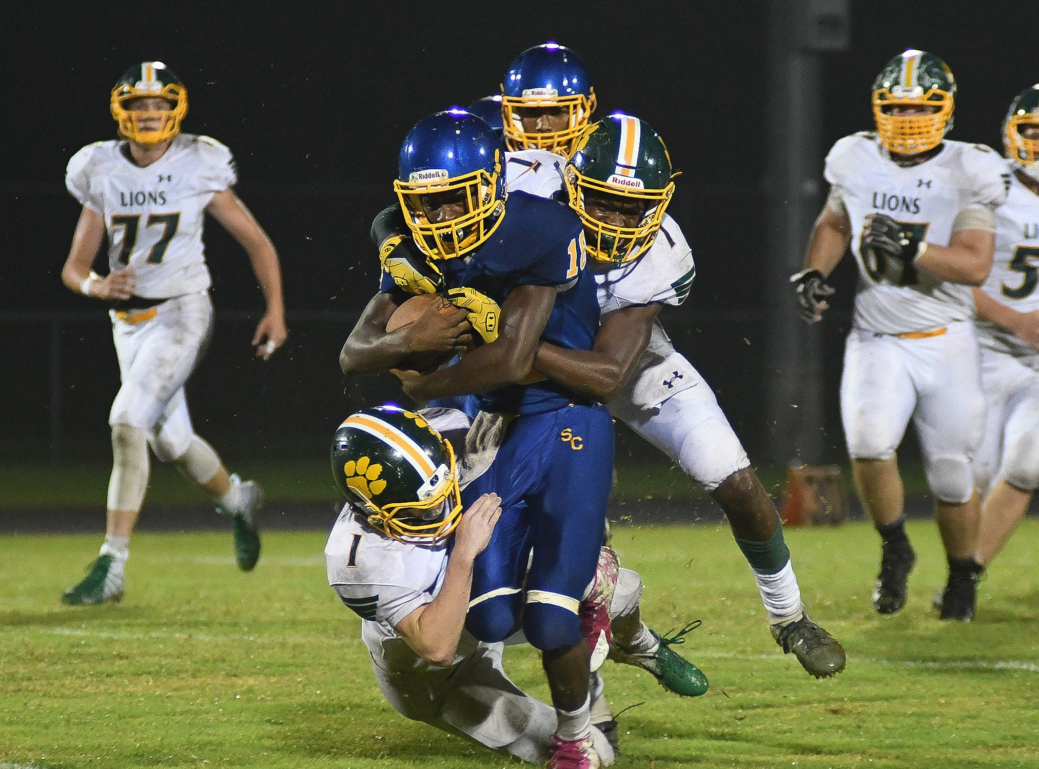 Sussex Central's Noah Simmons (18) with the carry against Queen Anne on Friday, Sept. 14, 2018.
