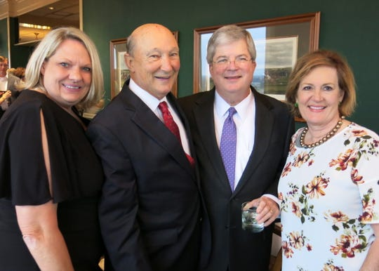 Ciny and Shreveport City Judge (Ret.) Bill Kelly, Jim and Sharla McMichael at Steve and Berry Glassell's 50th wedding anniversary dinner.