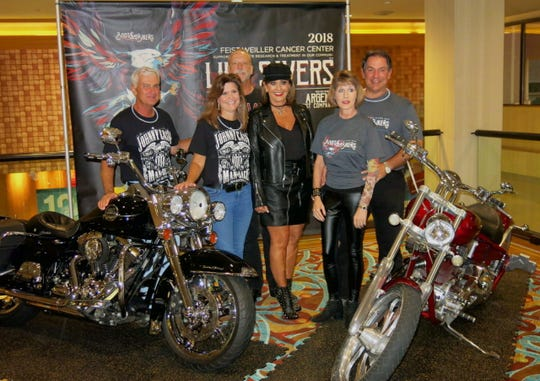 Photo op at Boots and Bikers: Gary and Amy Huddleston, Morris Nichols and Waynette Ballengee, Debbie and Steve Holloway.