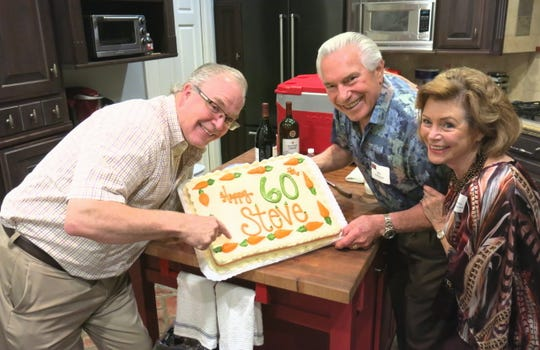 Shreveport Opera General Artistic Director Steve Aiken, Bob and JoAnna Robinson show off Aiken's birthday cake at the SOX Artist Meet & Greet and Housewarming Party.