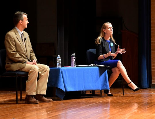 Del. Ben Cline R-24 and Jennifer Lewis face off in the first debate at Spotswood High School to determine which candidate will take over Bob Goodlatte's seat in the House of Representatives.