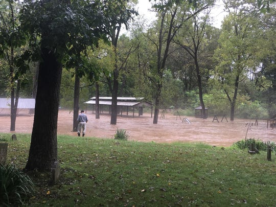 Dolan Puffenbarger of Buffalo Gap watches water rush by the playground behind the Churchville Recreation Center on Monday, September 17, 2018.