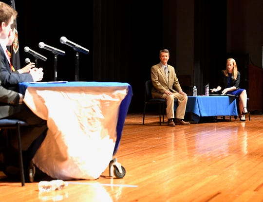 A panel of four high school students at Spotswood High School ask Del. Ben Cline and Jennifer Lewis questions at the first congressional debate between the nominees.