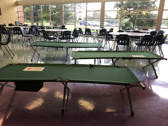 Cots set up at Kate Collins Middle School Monday, Sept. 17, 2018.