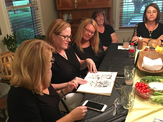 Members of the Buffalo Gap 1984 girls basketball state championship team reminisce while looking at their yearbook. From left, Kimberly Dawn Huffer Miller, Joy Ray Lohr, Mary Witherow-Mayhew, Sherry Rexrode Cox and Donna Newsome Perez.