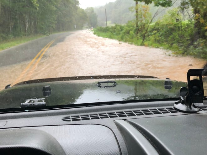 Water covers Mount Torrey Road in the Sherando area Monday morning, Sept. 17, 2018.
