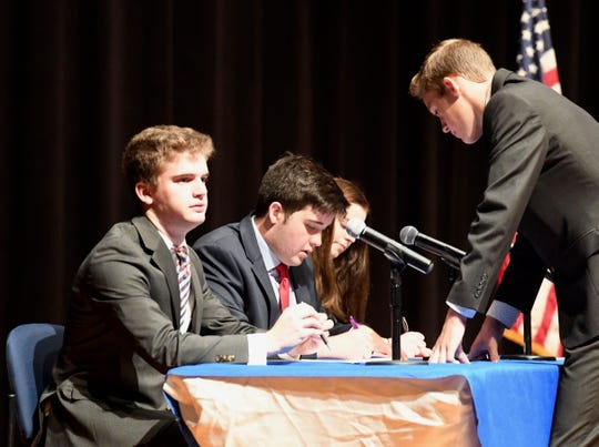 A panel of four students prepare for the debate between congressional nominees Jennifer Lewis and Del. Ben Cline.