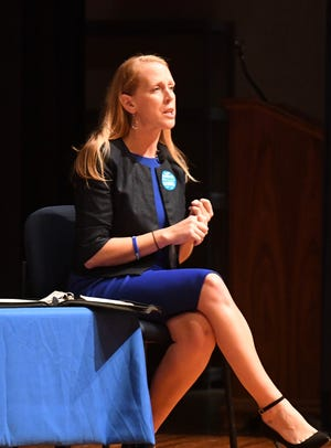 Democratic nominee Jennifer Lewis of Waynesboro debates Del. Ben Cline at Spotswood High School Sept. 17.