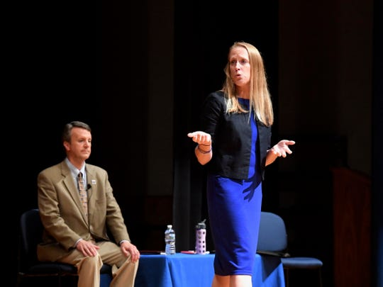 Democratic nominee Jennifer Lewis debates Del. Ben Cline at the Spotswood High School debate Sept. 17.