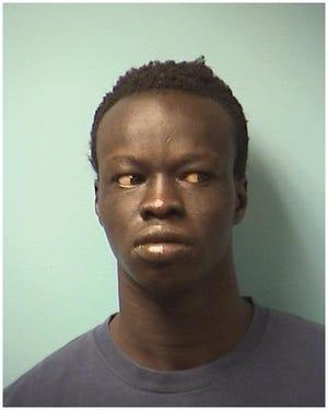 Jacob Nhial Elijah, 25, charged with first-degree burglary.