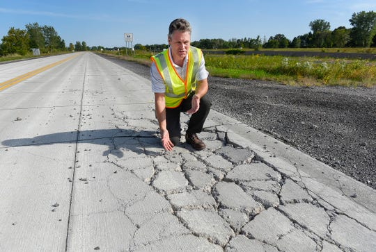 Ben Worel, Minnesota Department of Transportation MnRoad research facility, shows a section of concrete in the test area that did not work Tuesday, Sept. 11, along Interstate 94 in Albertville.