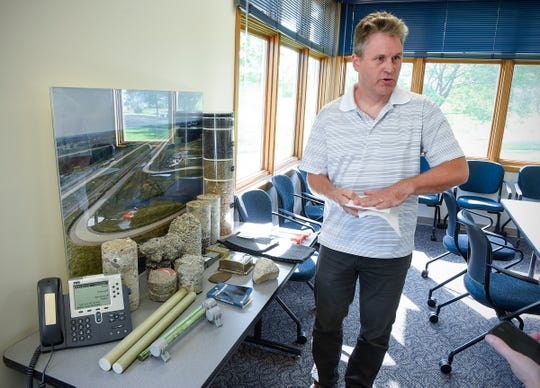 Ben Worel, research operations engineer at the Minnesota Department of Transportation MnROAD research facility, explains some of the different types of testing done Tuesday, Sept. 11, along Interstate 94 in Albertville.
